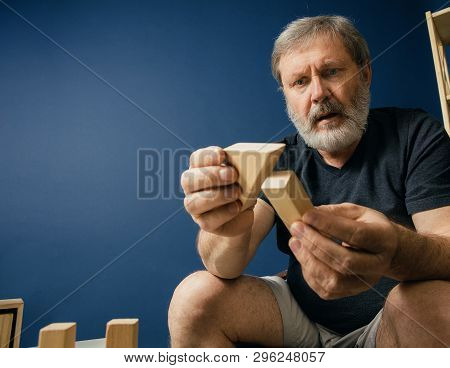 Vain Trying To Build New Life. Old Bearded Man With Alzheimer Desease Has Problems With His Hands Mo