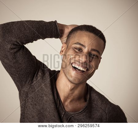 Portrait Of Young Attractive Stylish African American Man Model Posing In Casual Clothes Against Neu