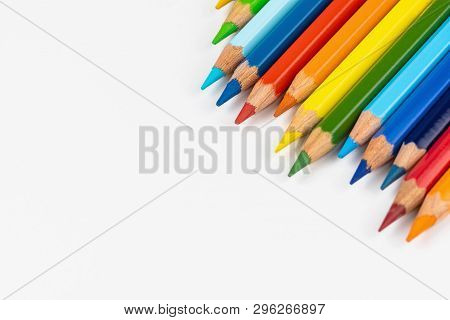 Set Of Colored Pencils. Colors Of Rainbow. Colored Pencils For Drawing Different Colors On A White B