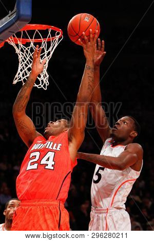 NEW YORK-MAR 10: Cincinnati Bearcats forward Justin Jackson (5) blocks Louisville Cardinals forward Chane Behanan (24) at the Big East Tournament on March 10, 2012 at Madison Square Garden in New York