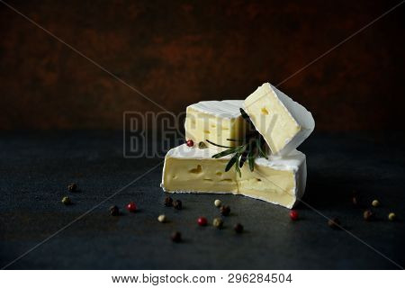Cheese Camembert Or Brie With Fresh Rosemary