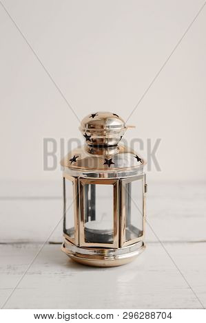 Gold Colored Lantern For Home Decor On Wooden Table