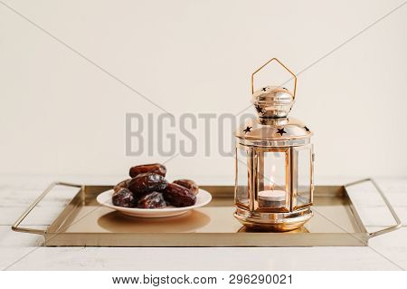 Tray With Gold Colored Lantern And Portion Of Dried Dates. Ramadan Month In The Middle East