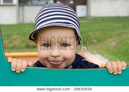 Young Boy Smiling On The Playground