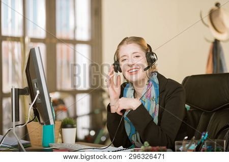 Young Professional Woman With Braces On A Headset Call