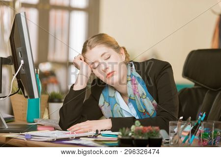 Overworked Creative Professional Woman Sleeping At Her Office Desk
