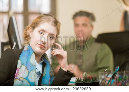 Young Professional Woman Reacting To Clueless Male Colleague