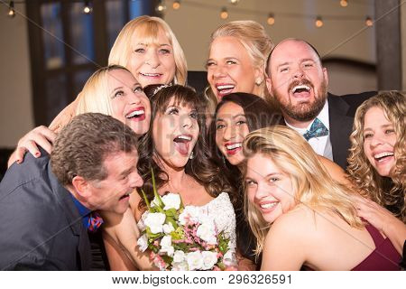 Friends Having Fun With The Bride At A Wedding