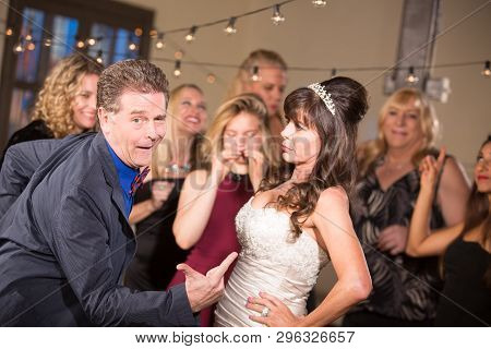 Bride Glares At Man Doing Funny Dance At A Wedding