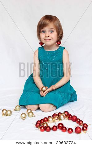 Cute Girl Playin With Christmas Decorations