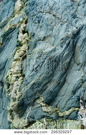 Background with green mineral rock close up, gemstone texture, olivine, amazonite, amphibolite, geology background poster