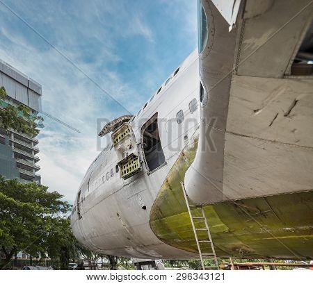 Plug Door Of Big Jumbo Jetliner Aircraft Are Being Repaired Or Under Maintenance At Open Air Hangar.