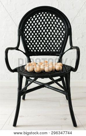 black armchair with eggs