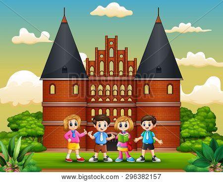 Cartoon Of Happy School Children Standing In Front Of Holstentor Building