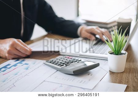 Businessman Accountant Working New Project On Laptop Computer With Report Document And Analyze Docum