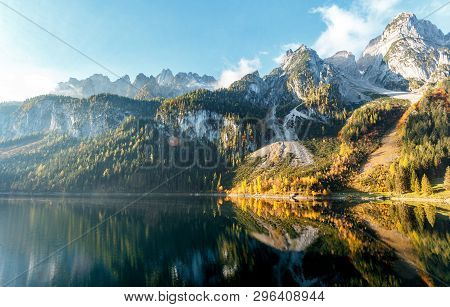 Majestic Alpine Highlands In Sunny Day. Unsurpassed Sunrise In The Mountains. Majestic Azure Lake Un