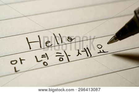 Beginner Korean Language Learner Writing Hello Word Annyeonghaseyo In Korean Characters On A Noteboo