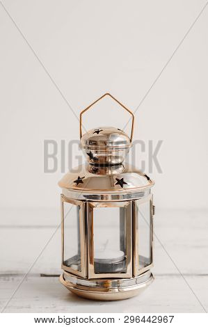 One Metal Lantern For Home Decor On White Wooden Table