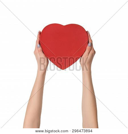 Female Hand Holding A Red Box In The Shape Of A Heart. Isolate On White Background.