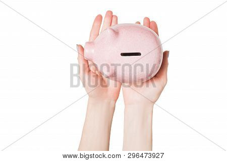 Pink Piggy Bank In Female Hands Isolate On A Light Background. View From Above.