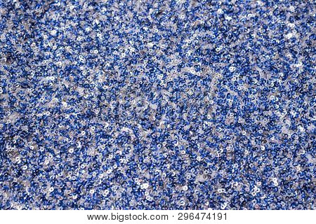 Fabric Texture With White And Blue Sequins. Close-up.