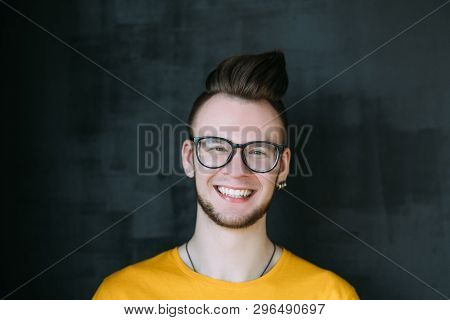Happy Young Man Portrait. Smiling Guy In Glasses With Comb Over Haircut Looking At Camera. Carefree