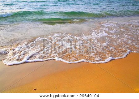 Beach with clear water and waves