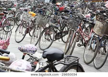 Plenty bicycles at parking lot in Beijing, China