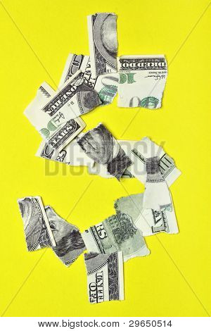 Lacerated banknote looking as dollar sign