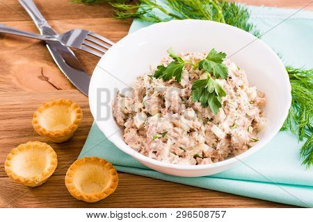 Salad From Canned Saury And Chicken Eggs And Empty Tartlets