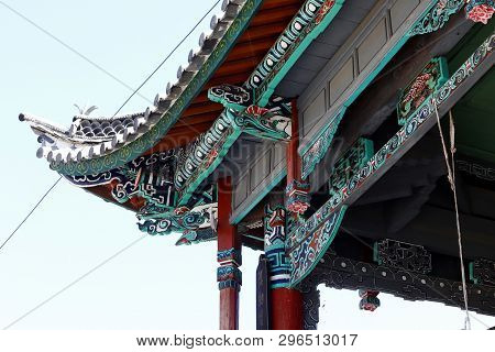 Shigu, Yunnan, China - November, 2018. Detail Of The Roof Decorations Of A Building In The Village O