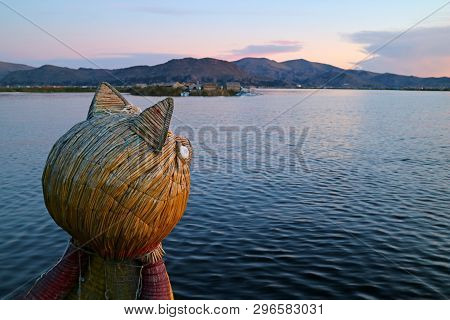 Traditional Totora Reed Boat With Puma Head Prow Against Lake Titicaca At Sunset, Puno, Peru