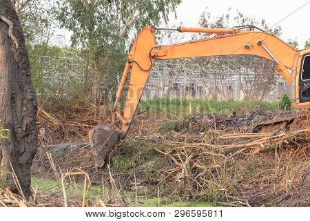 Excavator crawler in construction site build the pond poster