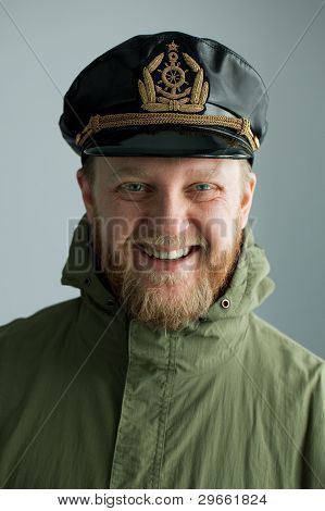 Young bearded sailor cap and green jacket poster