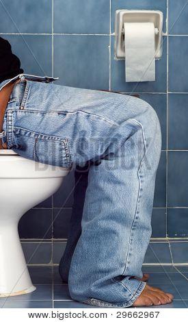 Man Sit In Blue Bathroom