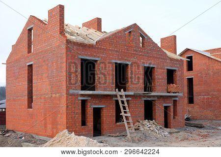 Unfinished Brick House Construction, Still Under Construction. Unfinished Roof Under Construction.