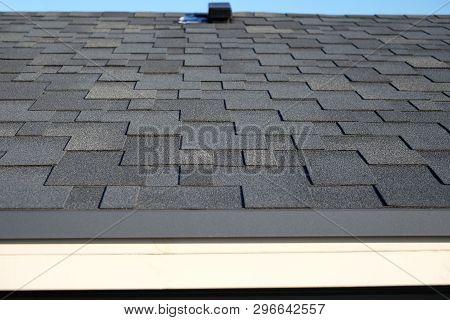 Close Up View On Asphalt Roofing Shingles Background. Roof Shingles - Roofing. Bitumen Tile Roof.