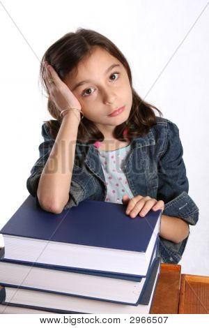 Young Girl With Stack Of Books