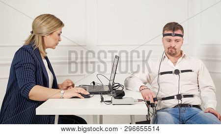 Young Handsome Suspect During Interrogation Undergoes Lie Detector Connected To The Machine He Answe