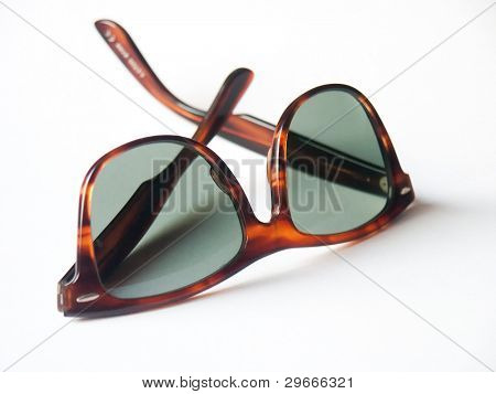 Vintage wayfarer sunglasses isolated on a white background.