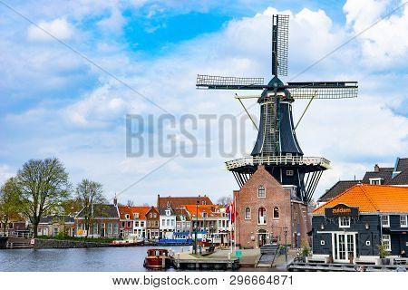 Haarlem, Netherlands - April 9, 2016: De Adriaan Traditional Dutch Windmill On Water Canal In Haarle