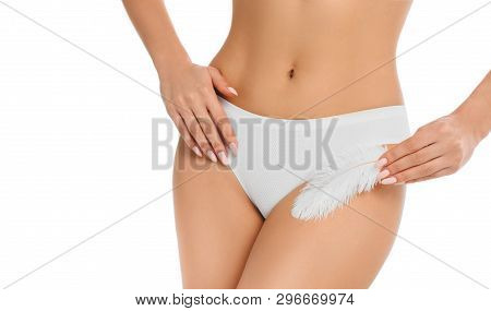 Woman Touching With Feather Her Genitals Wearing Panties , Showing Smooth Skin After Epilated Or Dep
