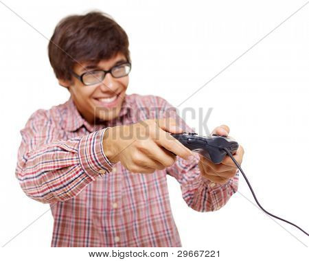Happy young man in glasses playing video game with joystick over isolated background, focus on joystick. Mask included