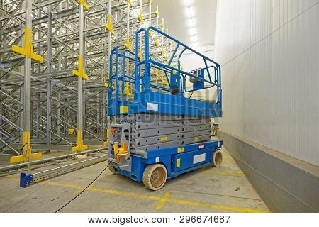 Scissor Lift Aerial Work Platform In Distribution Warehouse