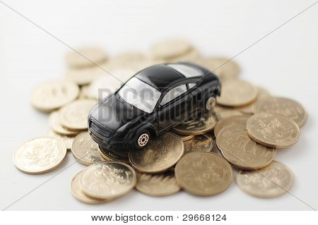 Stacked coins  and toy car
