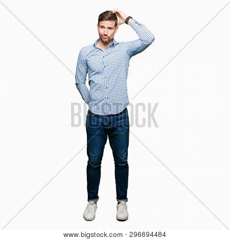 Handsome business man with blue eyes confuse and wonder about question. Uncertain with doubt, thinking with hand on head. Pensive concept.