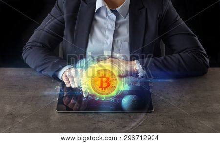 Business woman working on tablet with cryptocurrency and network concept