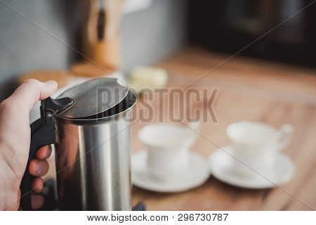 Preparing a traditional italian style coffee with coffee percolator. Making a coffe. poster