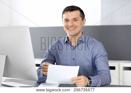 Cheerful Smiling Businessman Working With Computer In Modern Office. Headshot Of Male Entrepreneur O