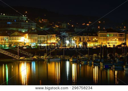 Baiona; Galicia, Night Landscape With Reflections In Water